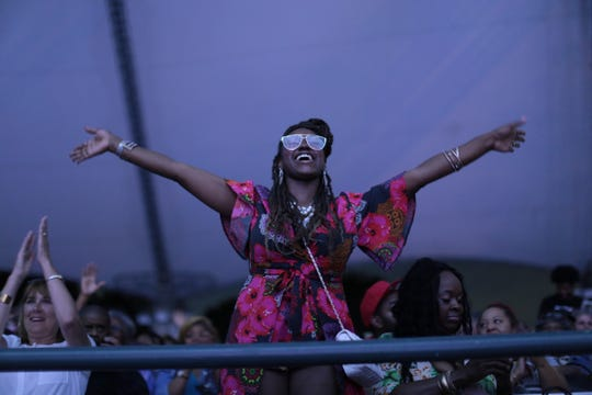 An Aretha Franklin fan celebrates during a Detroit tribute concert Thursday that honored the Queen of Soul.
