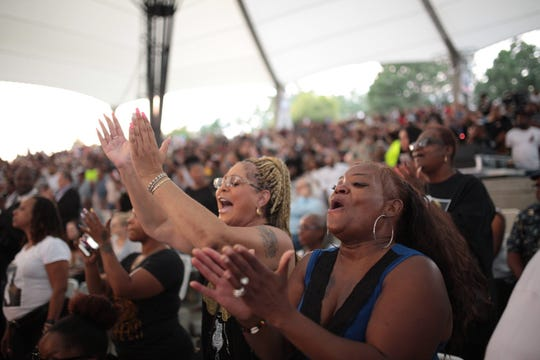 People cheer during an Aretha Franklin tribute concert at Chene Park Amphitheatre in Detroit on Thursday, August 30, 2018.