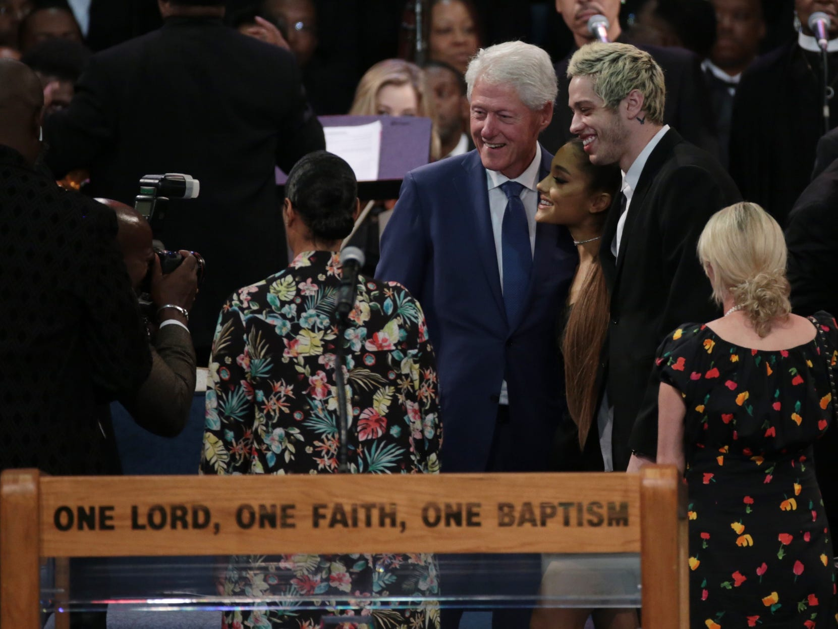 Singer Ariana Grande and Pete Davidson pose for a photo with former president Bill Clinton during the funeral for the late Aretha Franklin at Greater Grace Temple in Detroit on Friday, August 31, 2018.