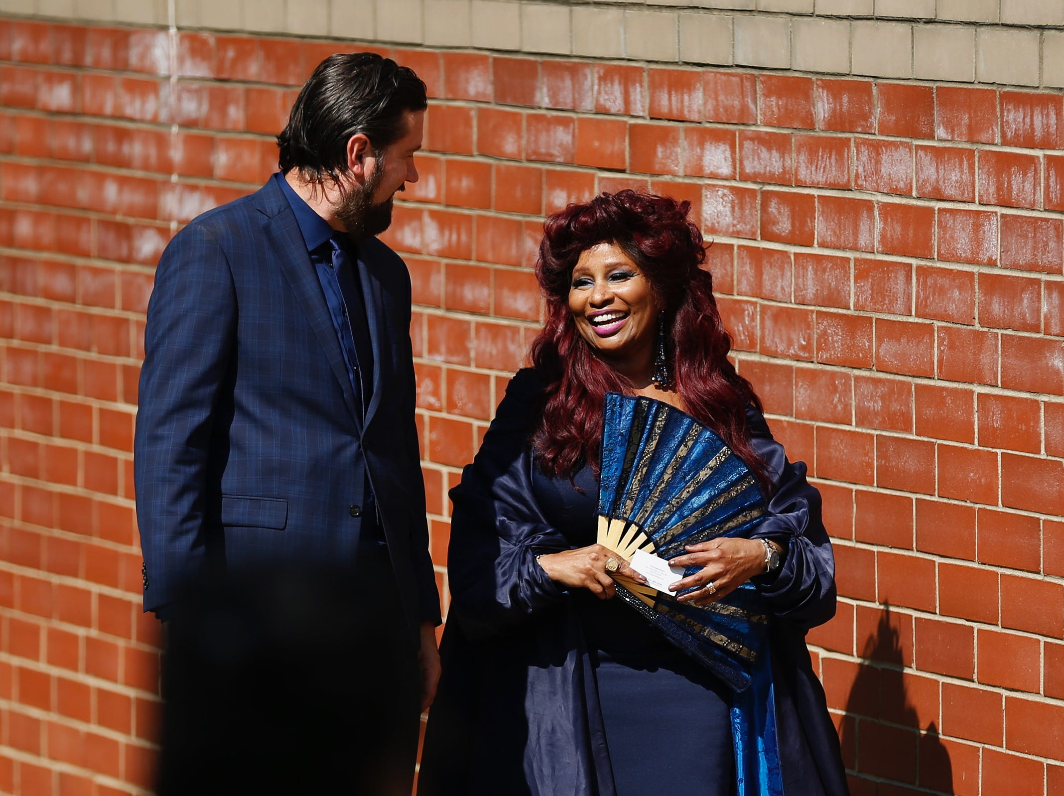 Chaka Kahn smiles as she exits Aretha Franklin's funeral at Greater Grace Temple in Detroit on Friday, August 31, 2018.