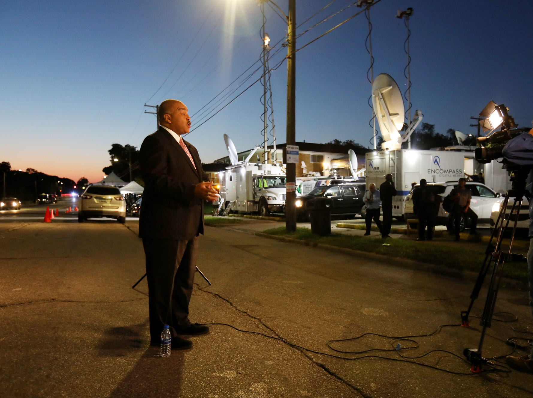 Mike Woolfolk, of NBC and FOX25 in Flint, reports from outside of the church as the sun begins to rise at Great Grace Temple in Detroit on Friday, August 31, 2018.