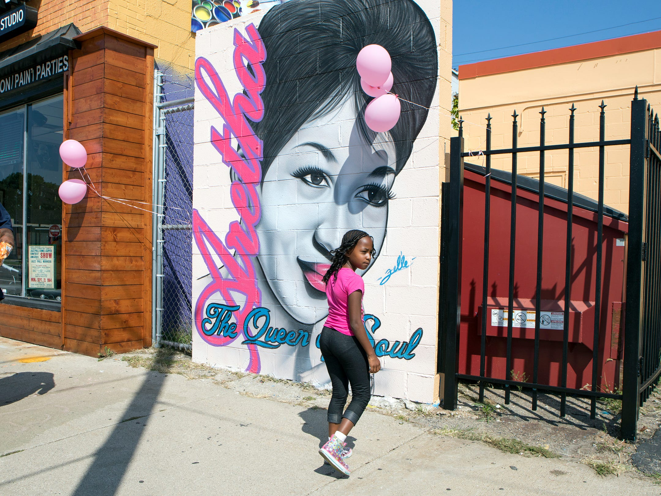 Cierra Forris, 8, of Detroit to strikes a pose in front the Aretha Franklin mural at Fel'li Gallery on Livernois Ave. in Detroit on Friday, August 31, 2018.