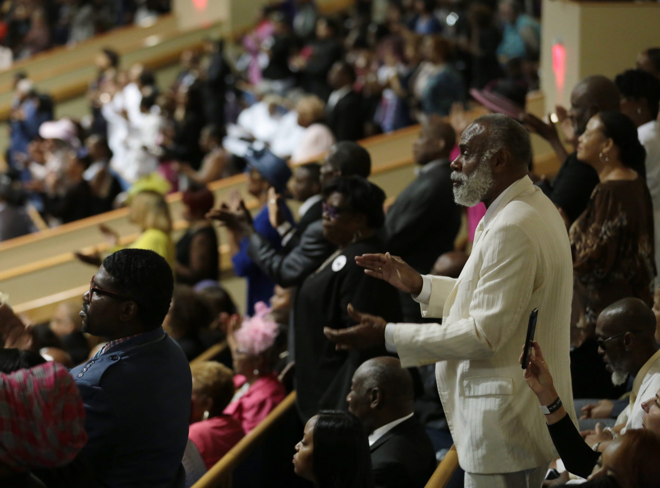 Crowd claps along to music during the funeral for the late Aretha Franklin at Greater Grace Temple in Detroit on Friday, August 31, 2018.