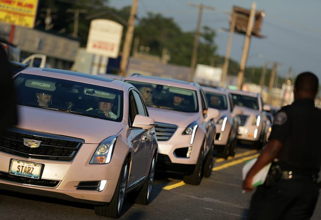 Pink Cadillacs arrive at Greater Grace Temple for the funeral of Aretha Franklin on Friday, August 31, 2018.