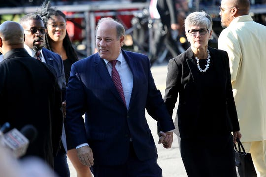 Detroit Mayor Mike Duggan and his wife, Lori Maher, arrive at Greater Grace Temple to pay their final respects to Aretha Franklin in Detroit, on Friday, Aug. 31, 2018.