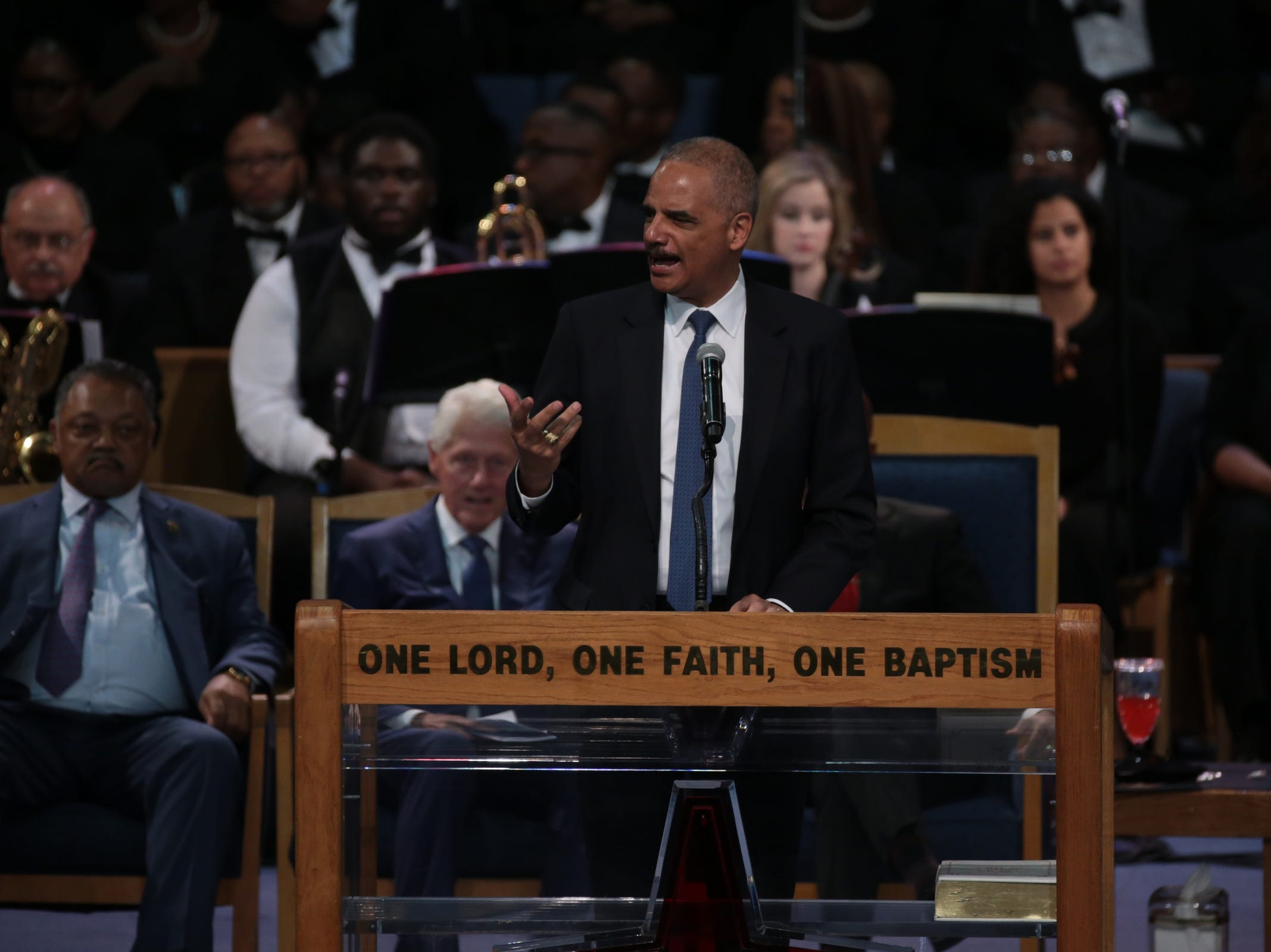 Former  U.S.  Attorney  General Eric  Holder speaks during the funeral for the late Aretha Franklin at Greater Grace Temple in Detroit on Friday, August 31, 2018.