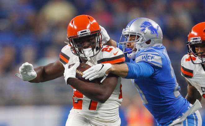 Detroit Lions defensive back Sterling Moore tackles Cleveland Browns running back Matt Dayes during the first half of a preseason game Thursday, Aug. 30, 2018, in Detroit.