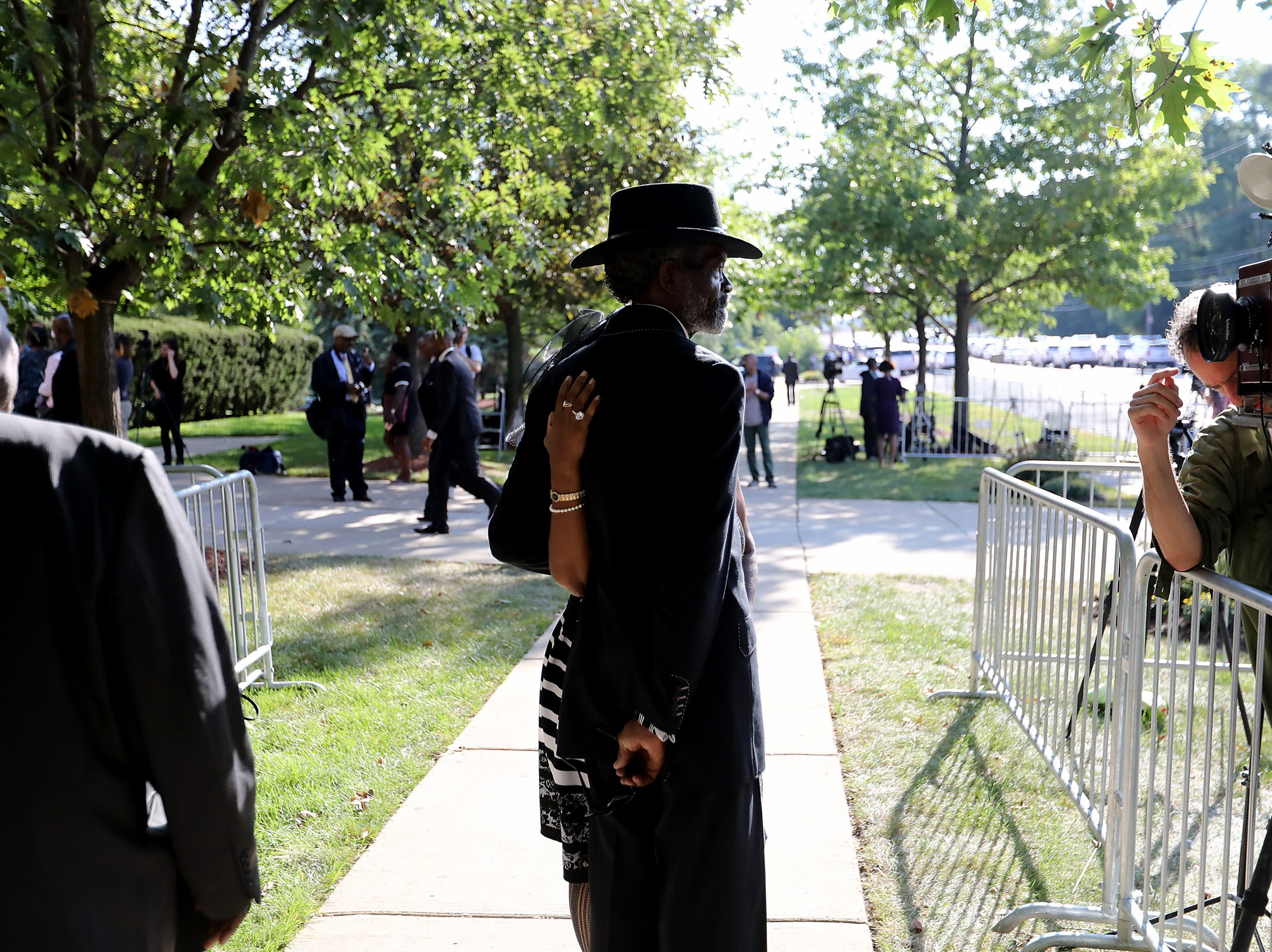 Ted and Cathy Mack of Mount Clemens get their photo taken outside at Greater Grace Temple to pay their final respects to Aretha Franklin in Detroit, on Friday, Aug. 31, 2018.