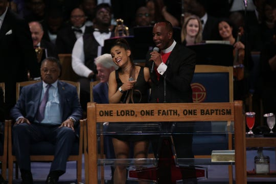 Bishop Charles H. Ellis III jokes with Ariana Grande after she performs a musical tribute during the funeral for the late Aretha Franklin at Greater Grace Temple in Detroit on Friday, Aug. 31, 2018.