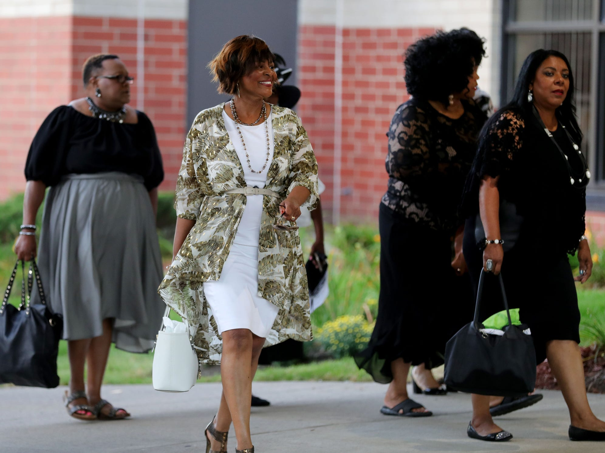 People arrive at Greater Grace Temple in Detroit to say their final goodbye to Aretha Franklin, Friday, August 31, 2018.