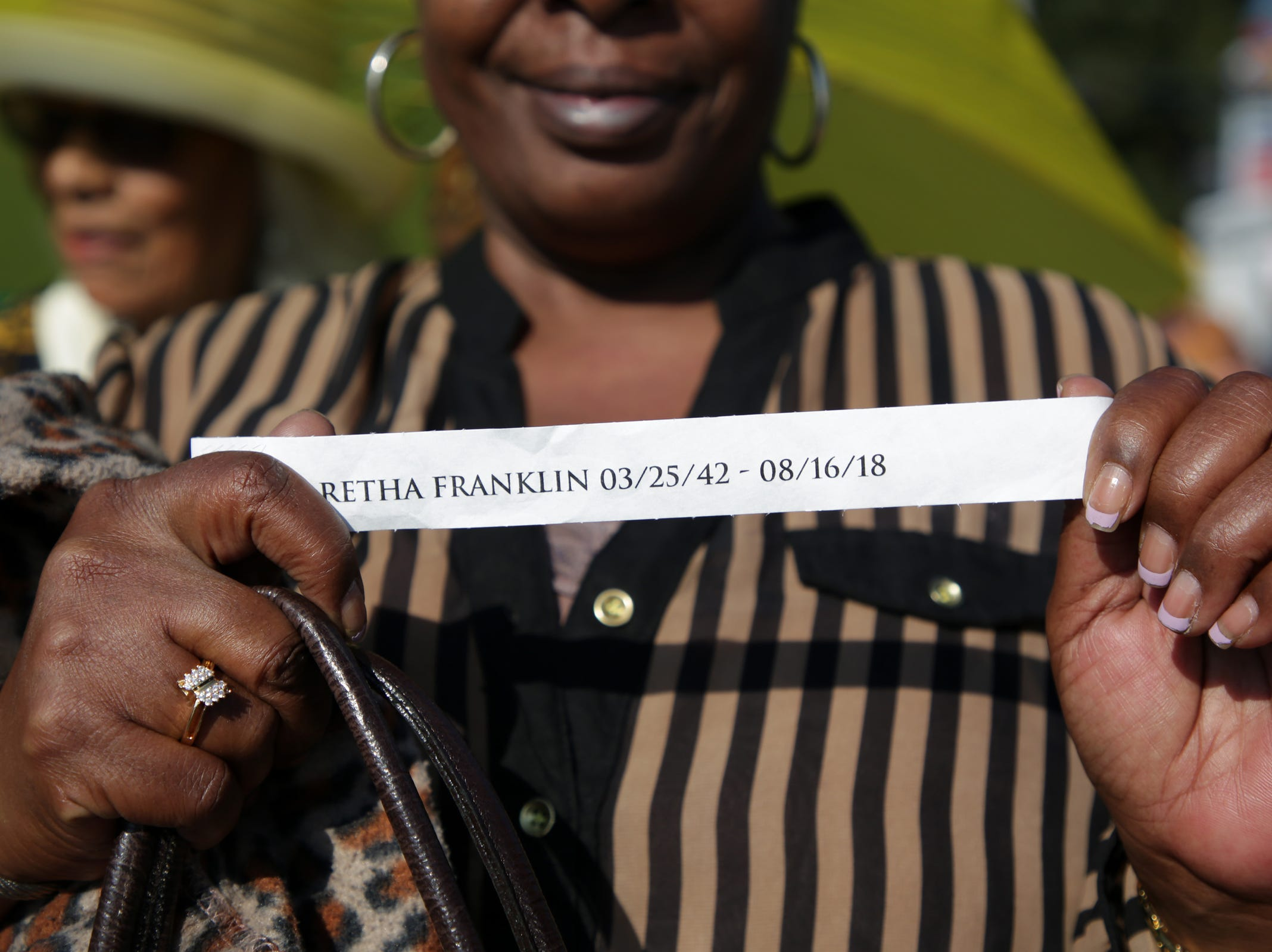 After having waited in line for several hours people put on their wrist band to be able to enter Greater Grace Temple for the funeral of Aretha Franklin on Friday, August 31, 2018.