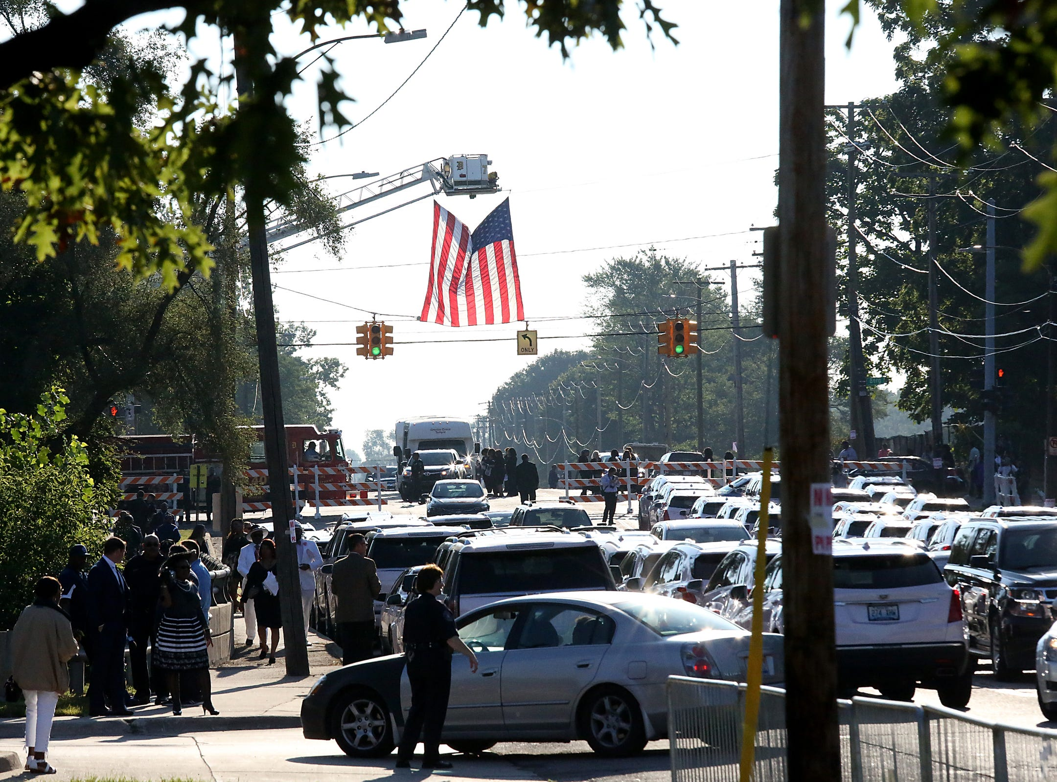 An American flag hangs over Seven Mile Road as people arrive at Greater Grace Temple to pay their final respects to Aretha Franklin in Detroit, on Friday, Aug. 31, 2018.