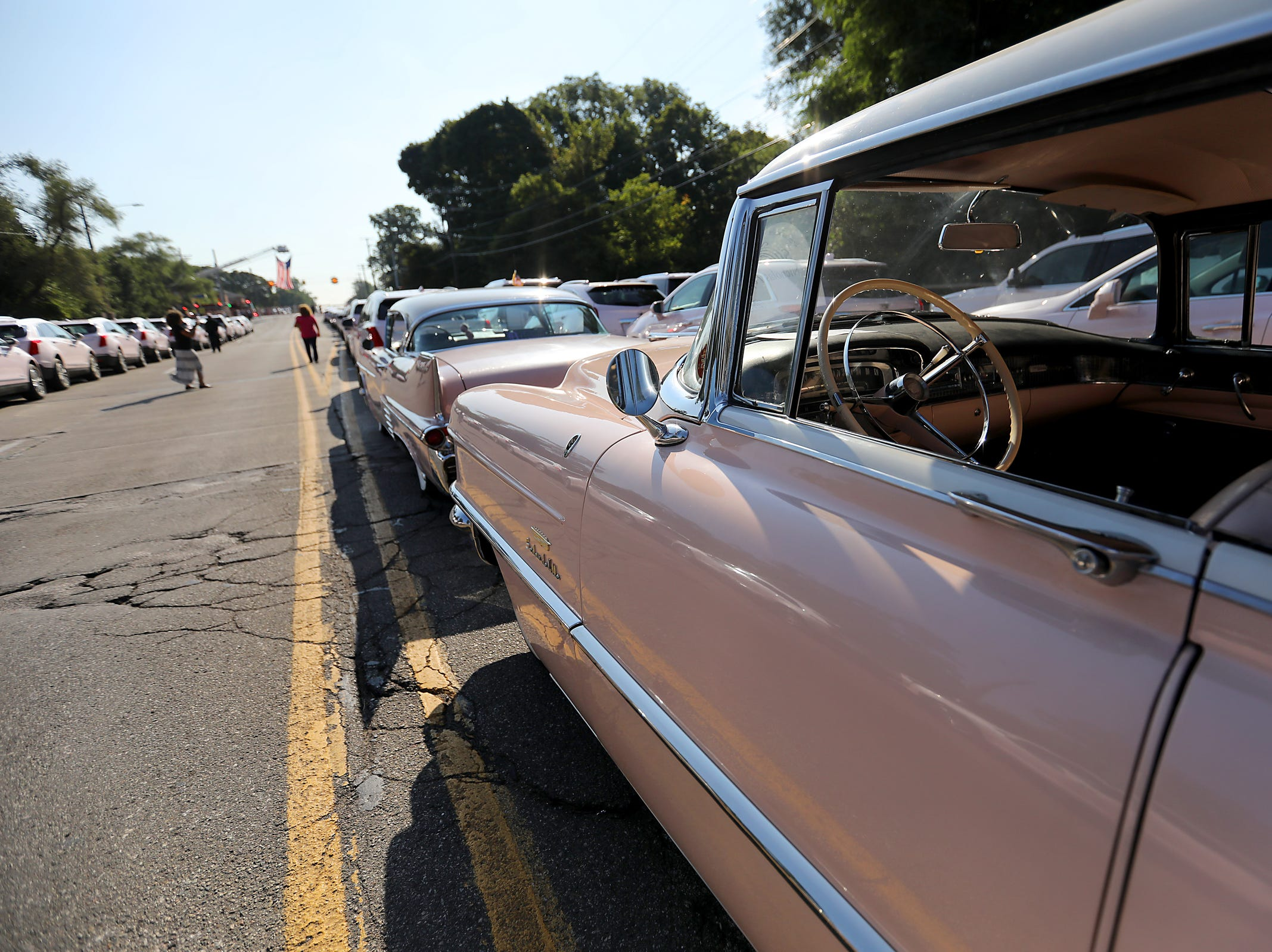 Hundreds of Mary Kay pink cadillacs are lined up along seven mile road at Greater Grace Temple as people pay their final respects to Aretha Franklin in Detroit, on Friday, Aug. 31, 2018.