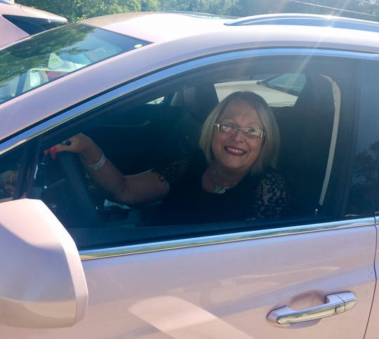 Deborah Dudas of Niles, Mich., sits in her pink Cadillac XT5, which will be part of Aretha Franklin's funeral procession.