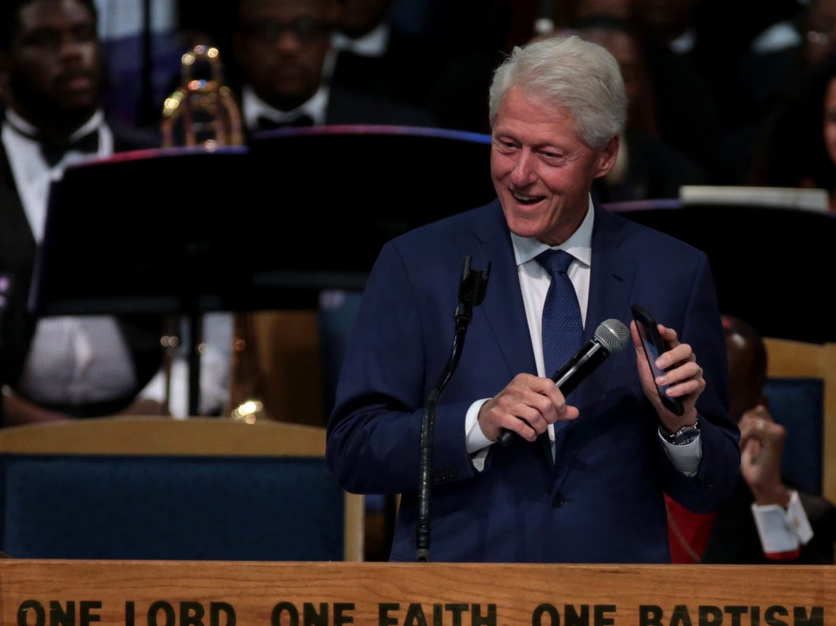 "Former president Bill Clinton plays ""Think"" by Aretha Franklin on his phone during the funeral for the late Aretha Franklin at Greater Grace Temple in Detroit on Friday, August 31, 2018."
