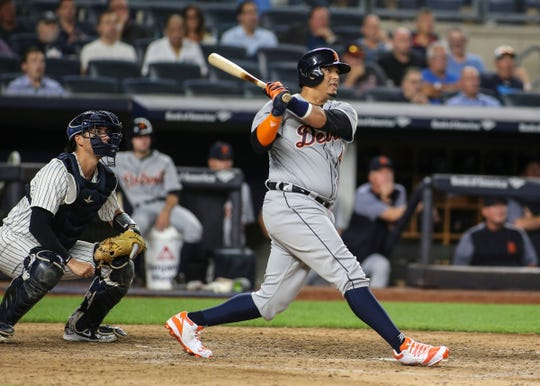 Detroit Tigers designated hitter Victor Martinez hits a tying two-run home run in the ninth inning against the New York Yankees at Yankee Stadium on Aug. 30, 2018 in the Bronx.