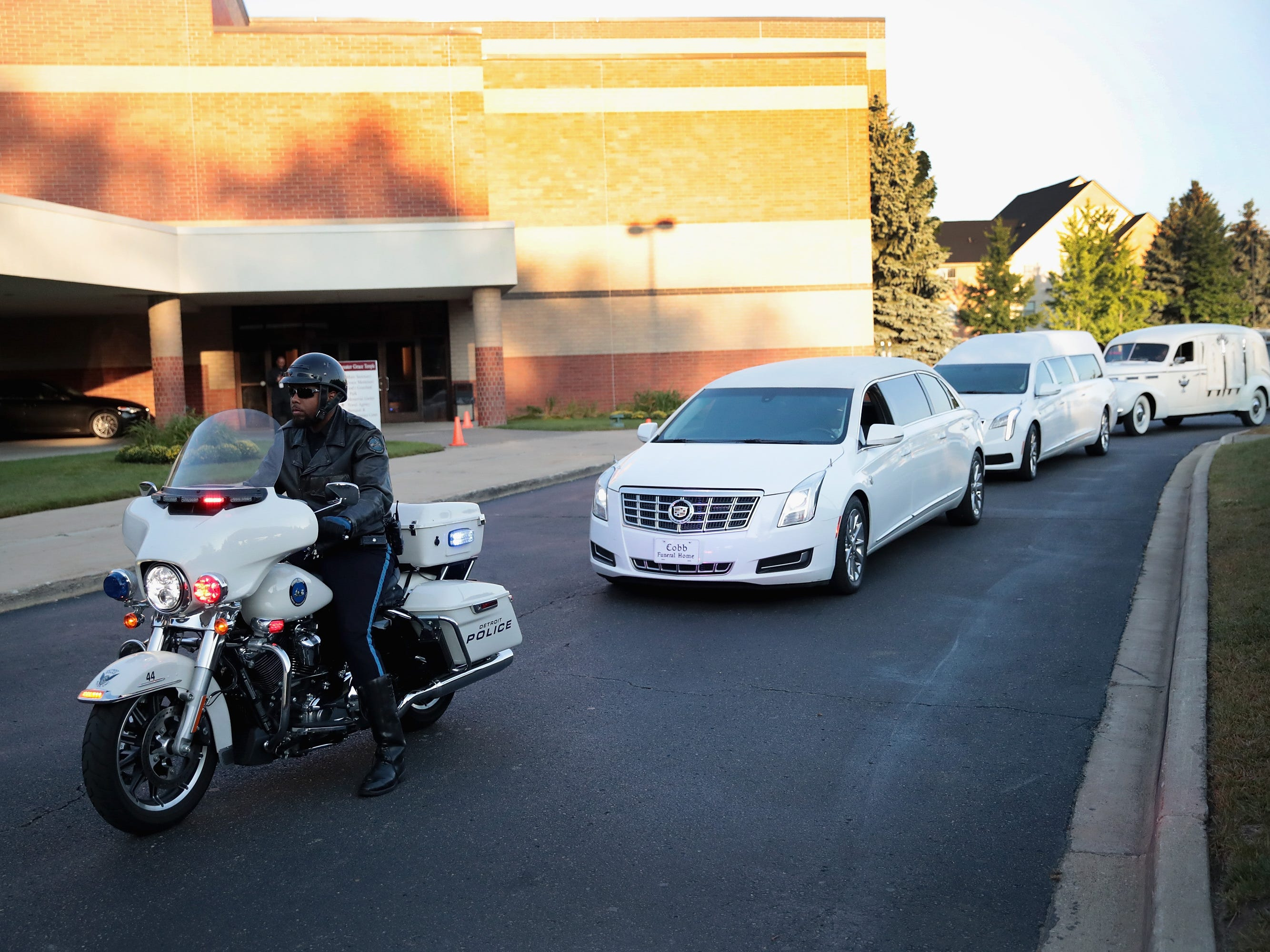 The remains of Aretha Franklin get a police escort to her funeral service at Greater Grace Temple.