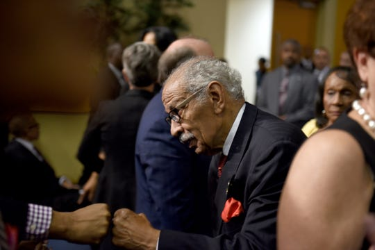 Former U.S. Congressman John Conyers gets a fist bump at the Aretha Franklin memorial at Greater Grace Temple.
