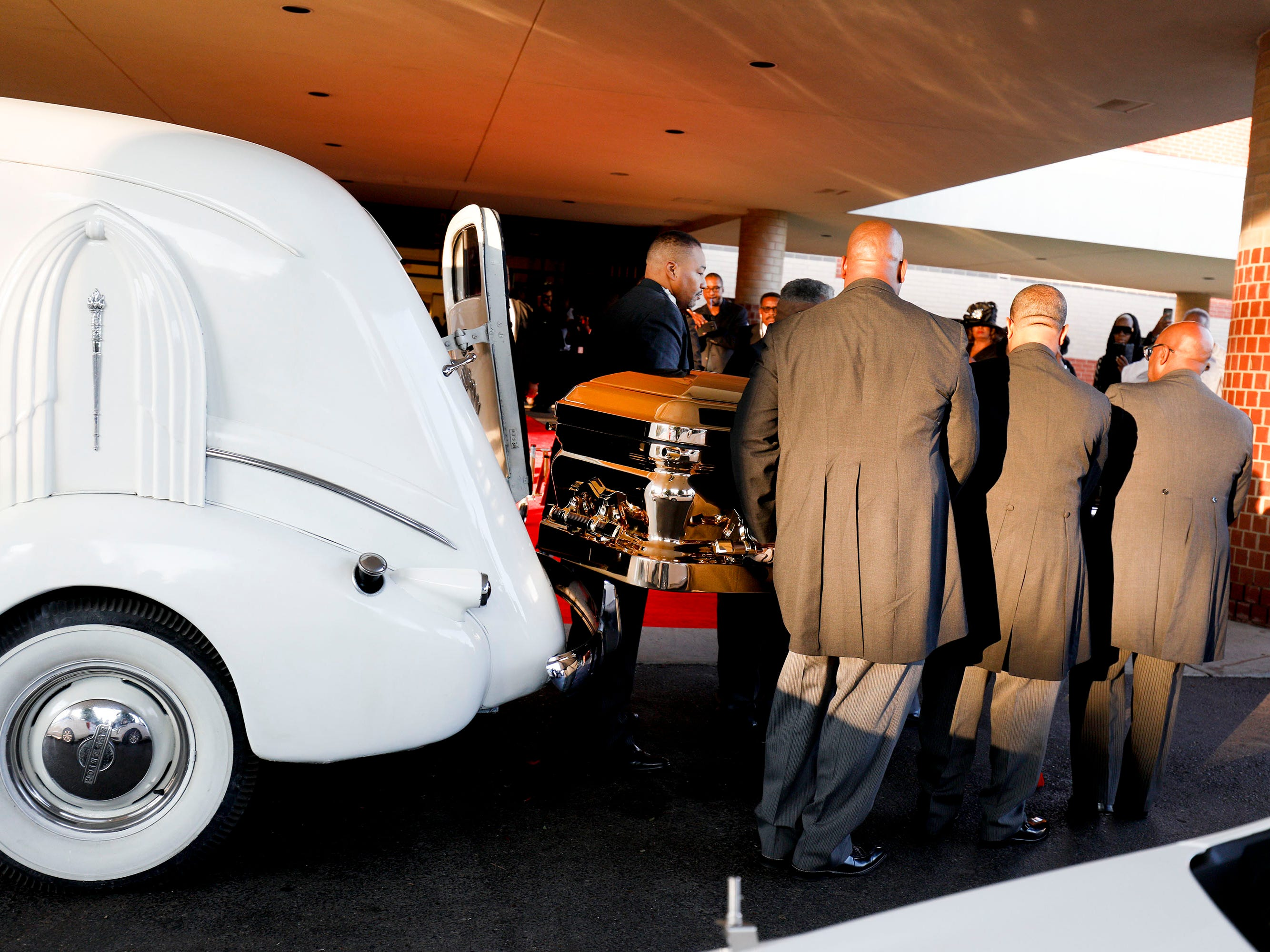 The casket containing the remains of soul music icon Aretha Franklin is carried into Greater Grace Temple for the singer's funeral.