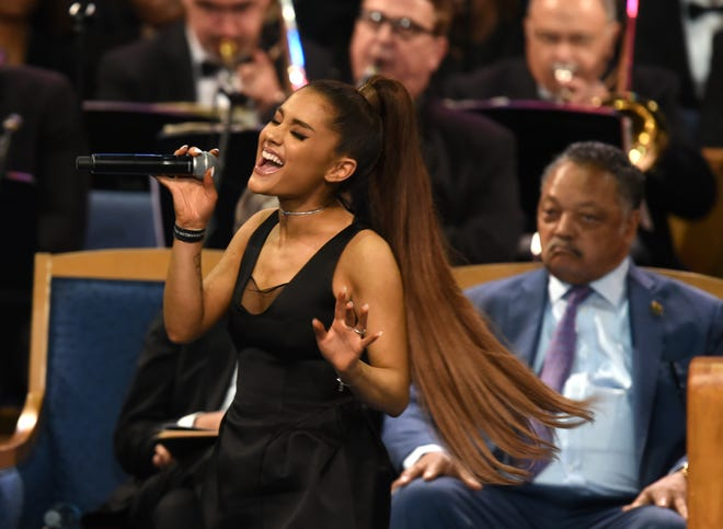 Ariana Grande performs in tribute to Aretha Franklin at her memorial service.