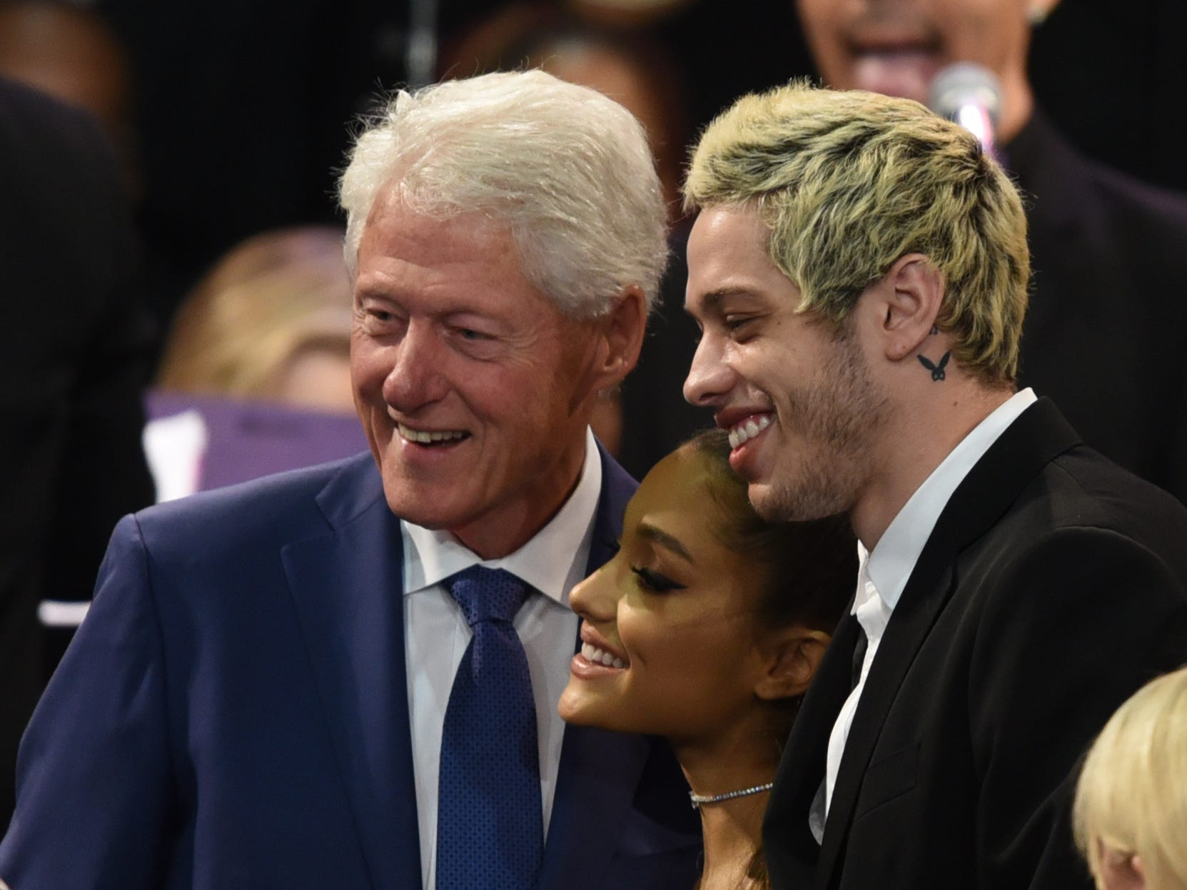 President Bill Clinton poses with Ariana Grande and comedian Pete Davidson during Aretha Franklin's memorial service at Greater Grace Temple.
