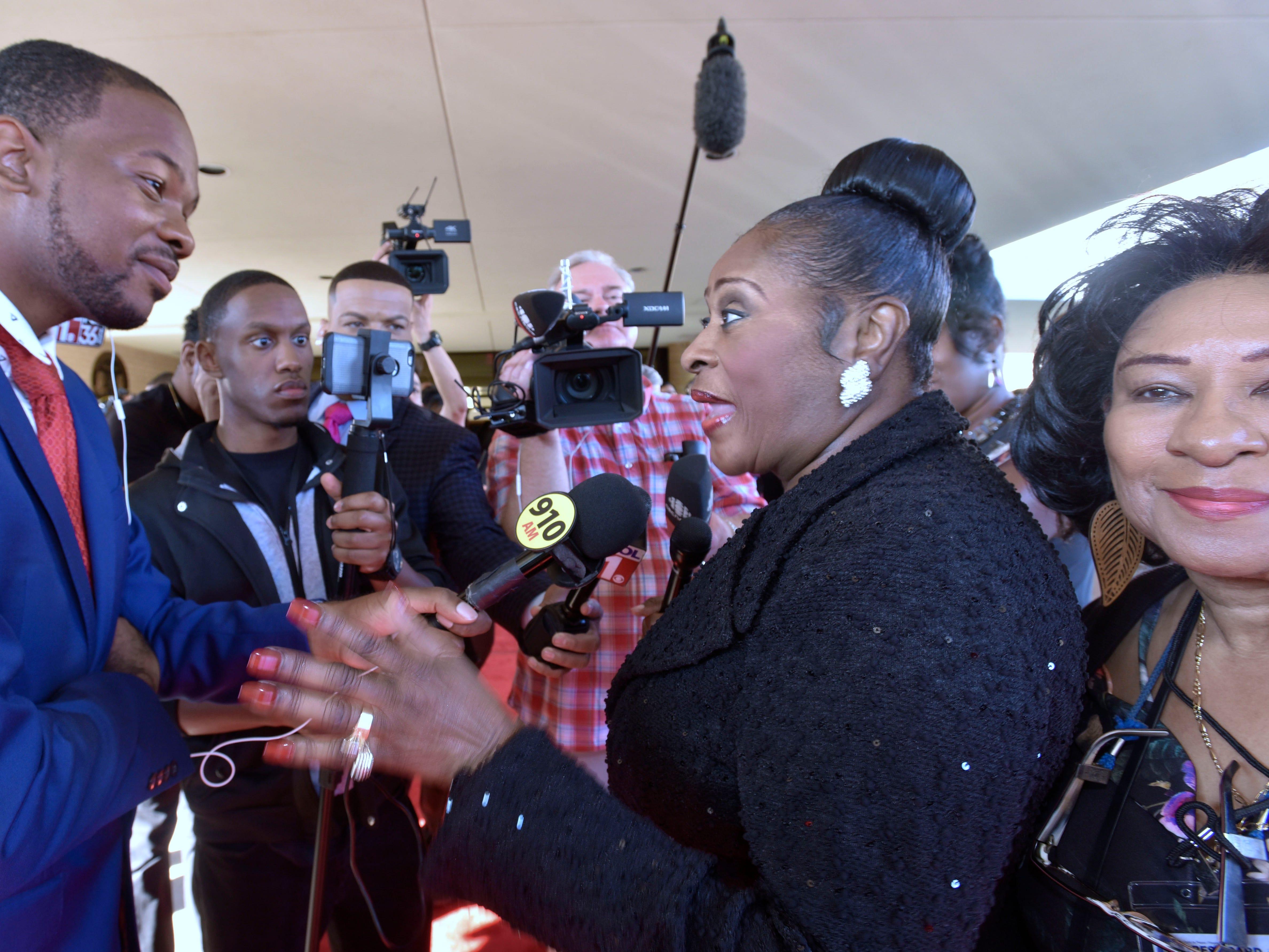 Gospel singer Dottie Peoples talks to reporters.