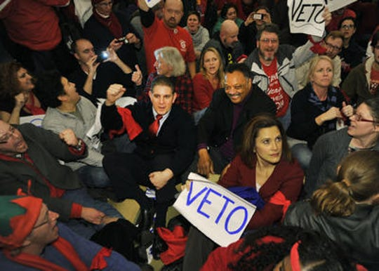 "Lansing Mayor Virgil ""Virg"" Bernero, left, the Rev. Jesse Jackson and then Michigan State Senate Minority Leader Gretchen Whitmer talk with people at a Right-to-Work sit in the Capitol in Lansing on Dec. 11, 2012."