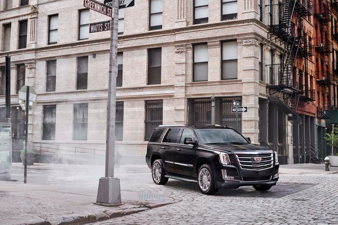 General Motors' Cadillac brand, maker of the Escalade SUV, is leaving its New York City headquarters to return to southeast Michigan.