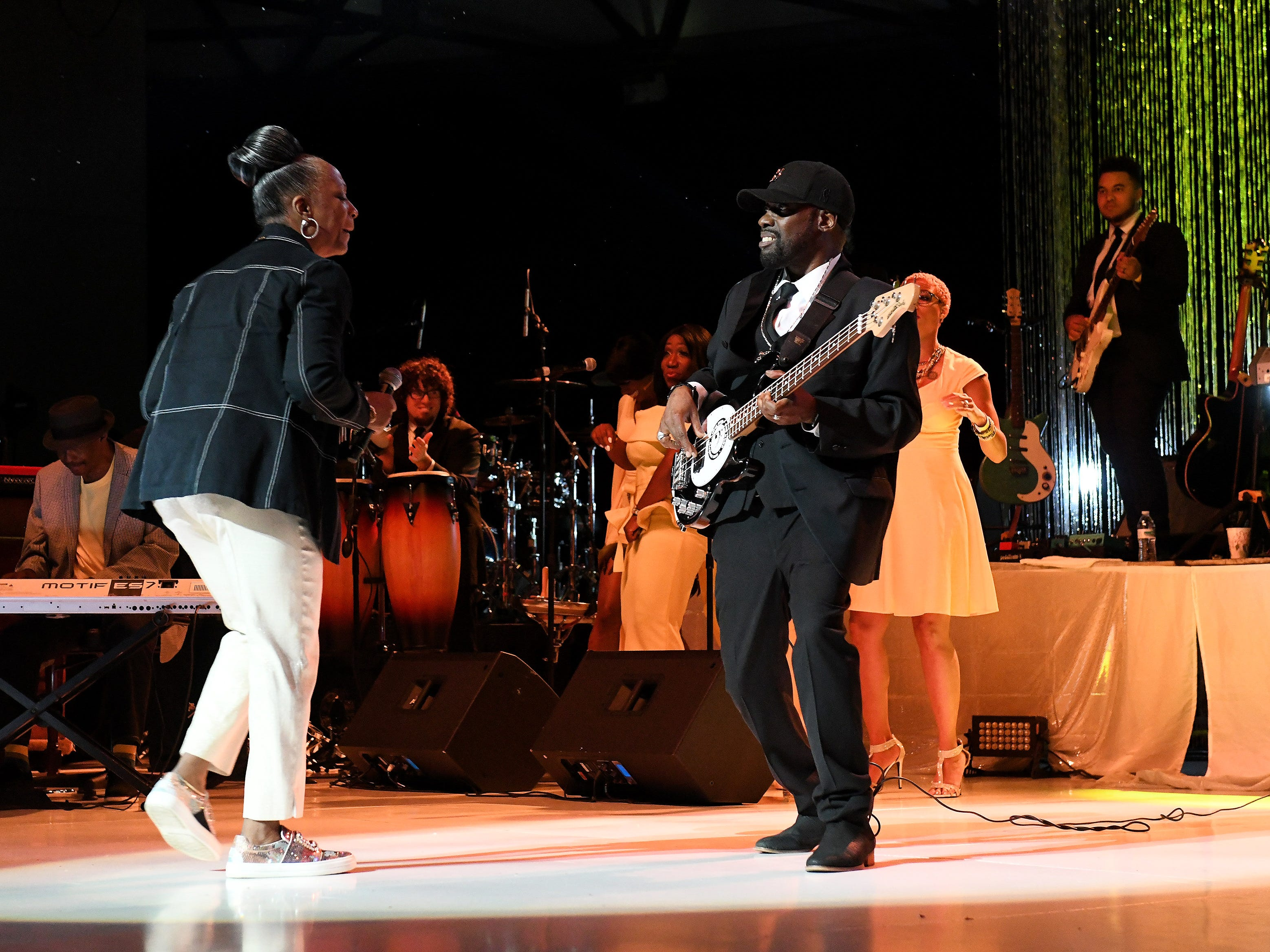 "Regina Belle, left, dances with the bass player during ""Rock Steady"" at the Aretha Franklin Tribute Concert."