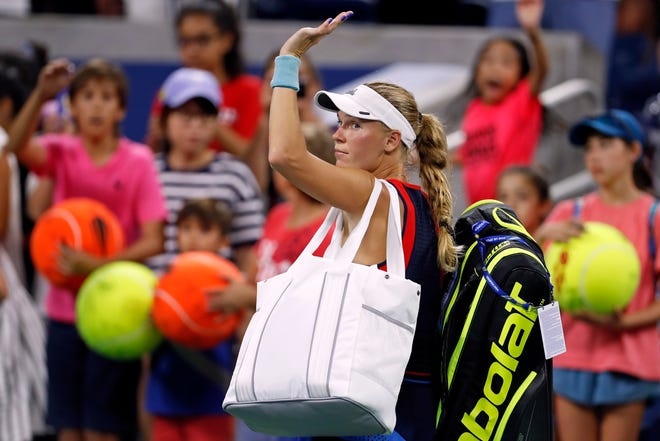 Caroline Wozniacki waves as she leaves the court after losing to Lesla Tsurenkoduring the second round of the U.S. Open tennis tournament on Thursday.