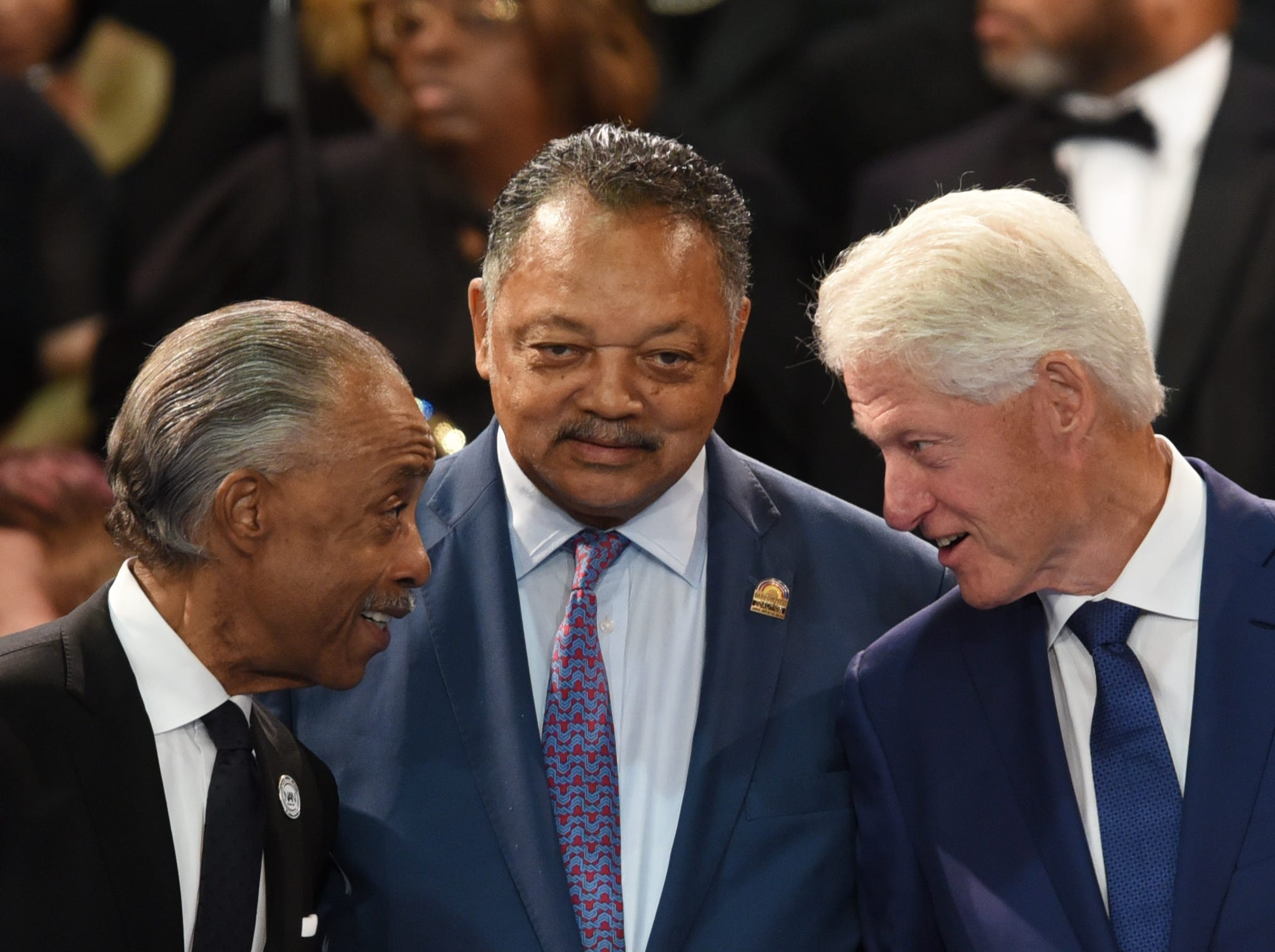 Rev. Al Sharpton (from left), Rev. Jesse Jackson, and President Bill Clinton speak to one another at the Aretha Franklin's funeral service at Greater Grace Temple on Friday, August 31, 2018.