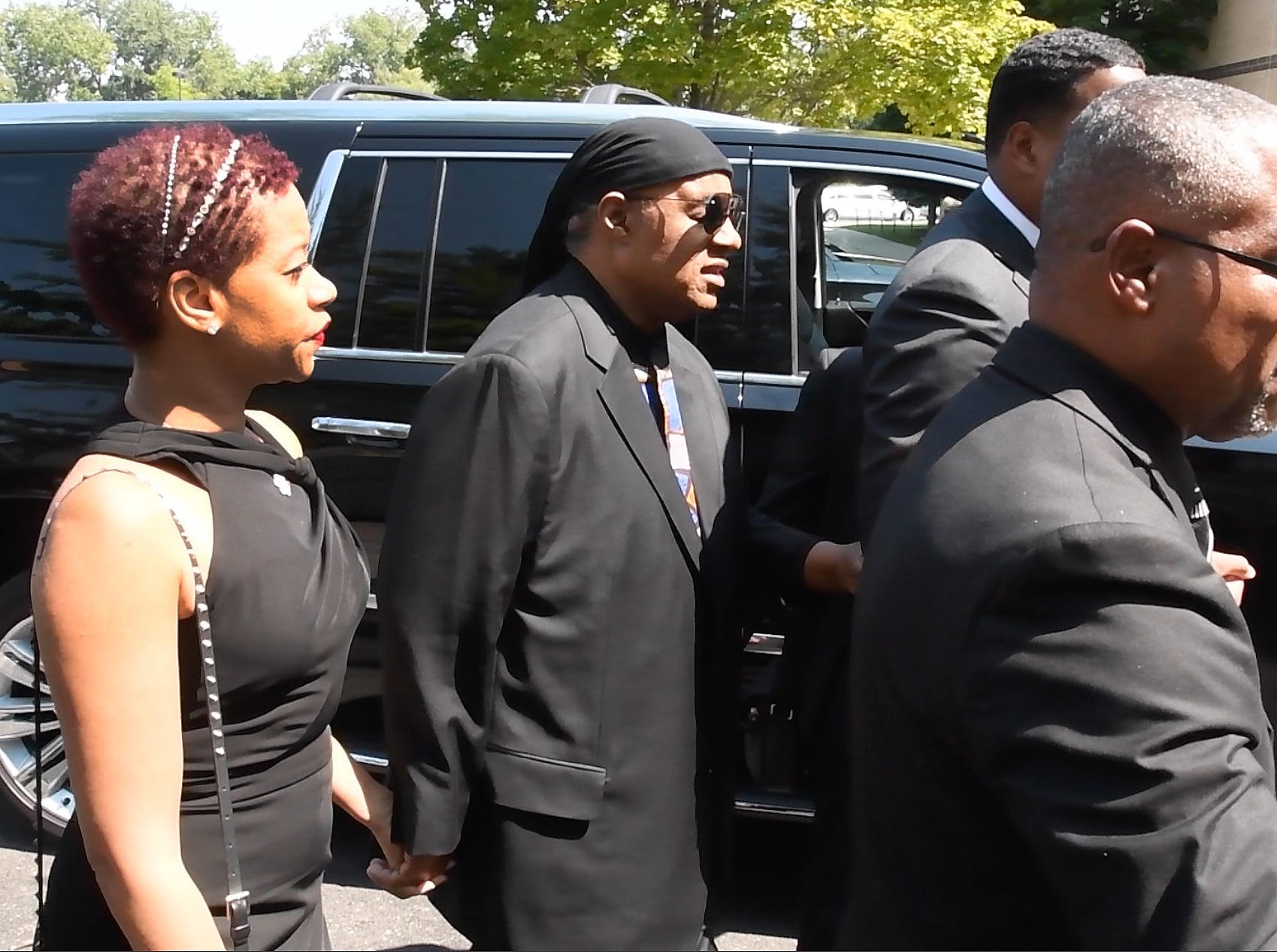 Stevie Wonder arrives at a rear door of Greater Grace Temple in Detroit before performing at Aretha Franklin's funeral service Friday.