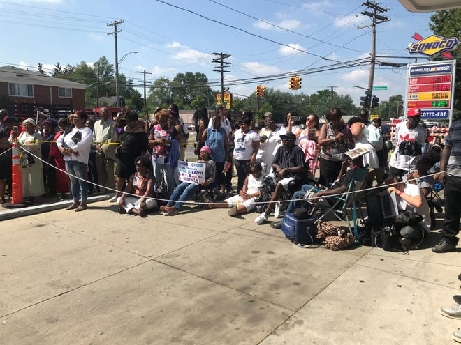For those who couldn't get into the church a Sonoco gas station down the street became an impromptu temple. They were gathered  around a screen projecting the funeral live, singing with pride along with the choir and cheering on preachers.