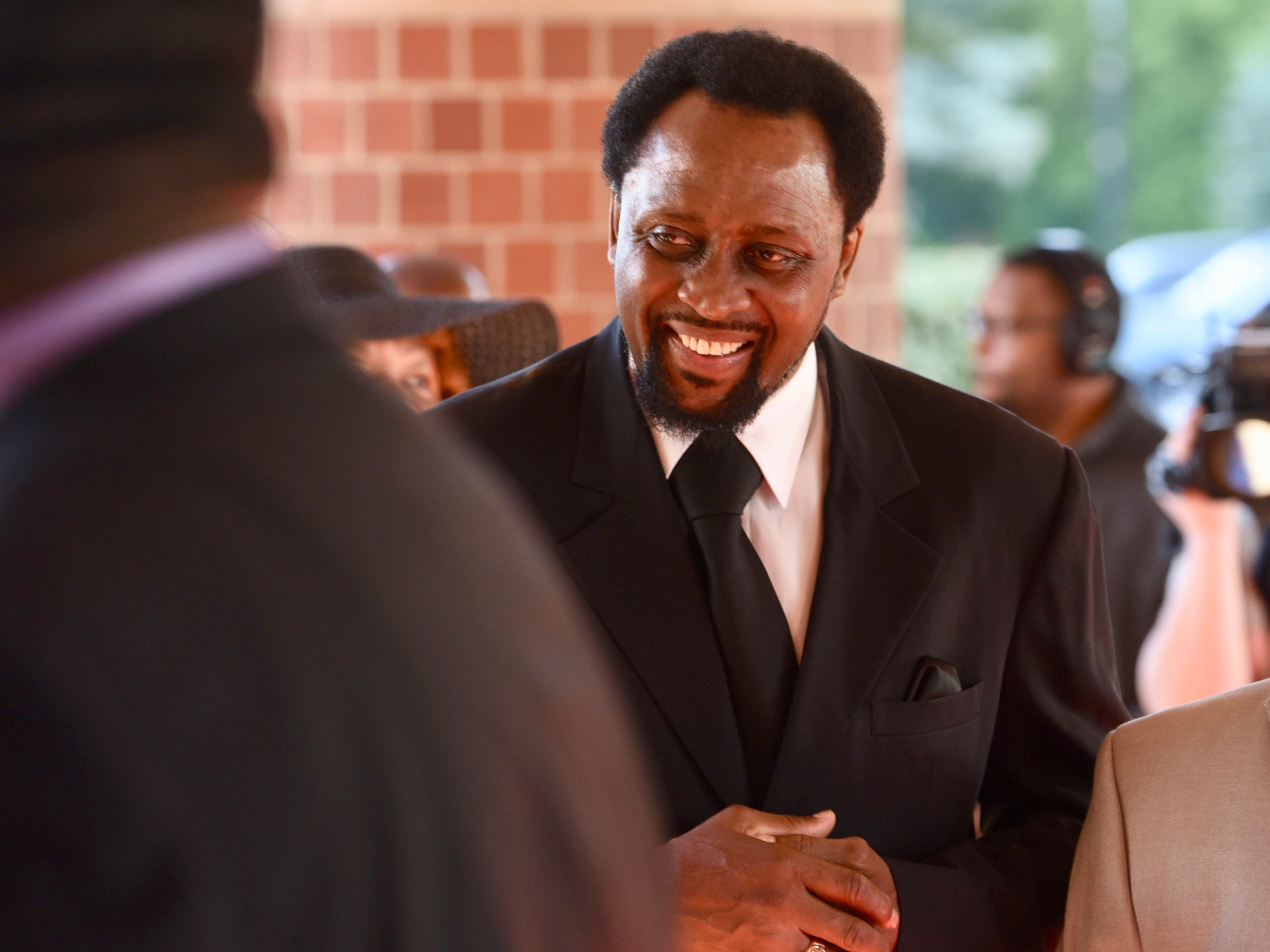 Boxing great Thomas Hearns arrives at the memorial service for Aretha Franklin.