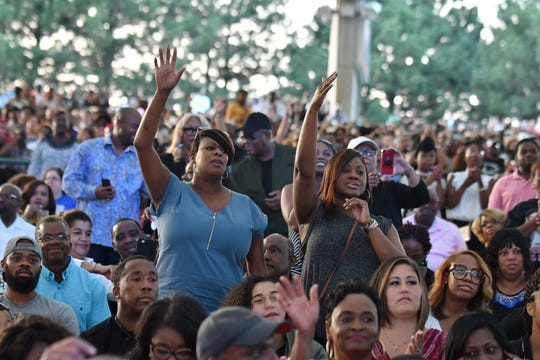 Fans enjoy the Aretha Franklin Tribute Concert at Chene Park Ampitheatre.