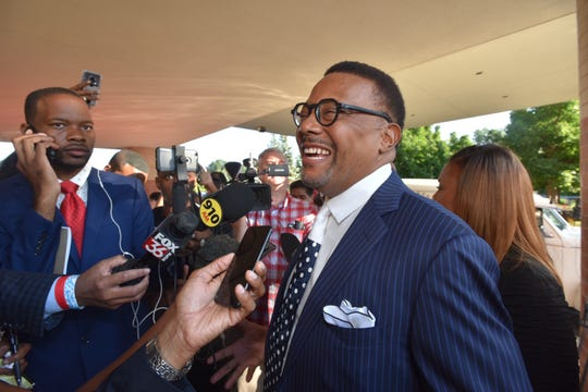 Judge Greg Mathis arrive for the funeral.
