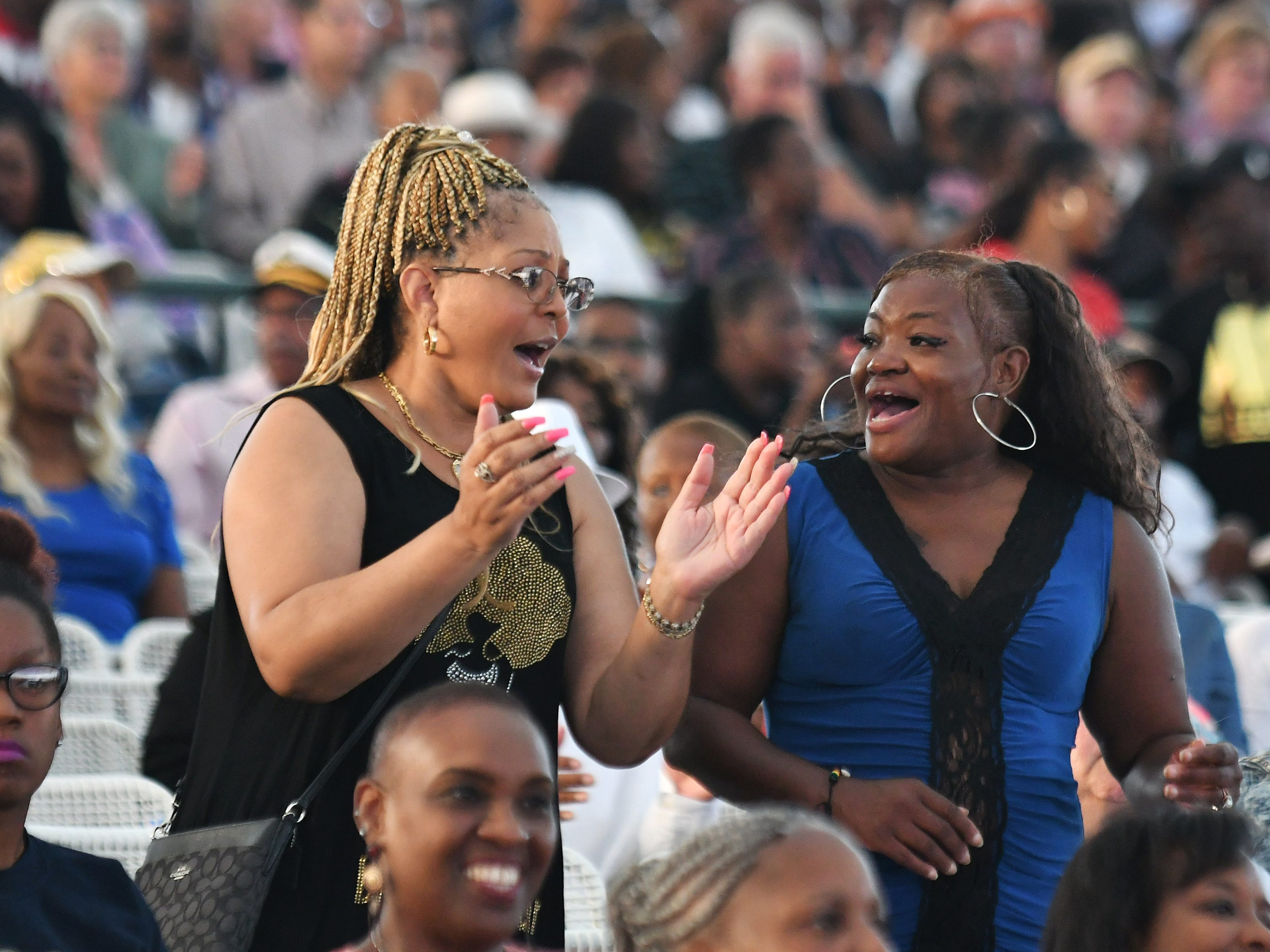 Two ladies enjoy the Aretha Franklin Tribute Concert.