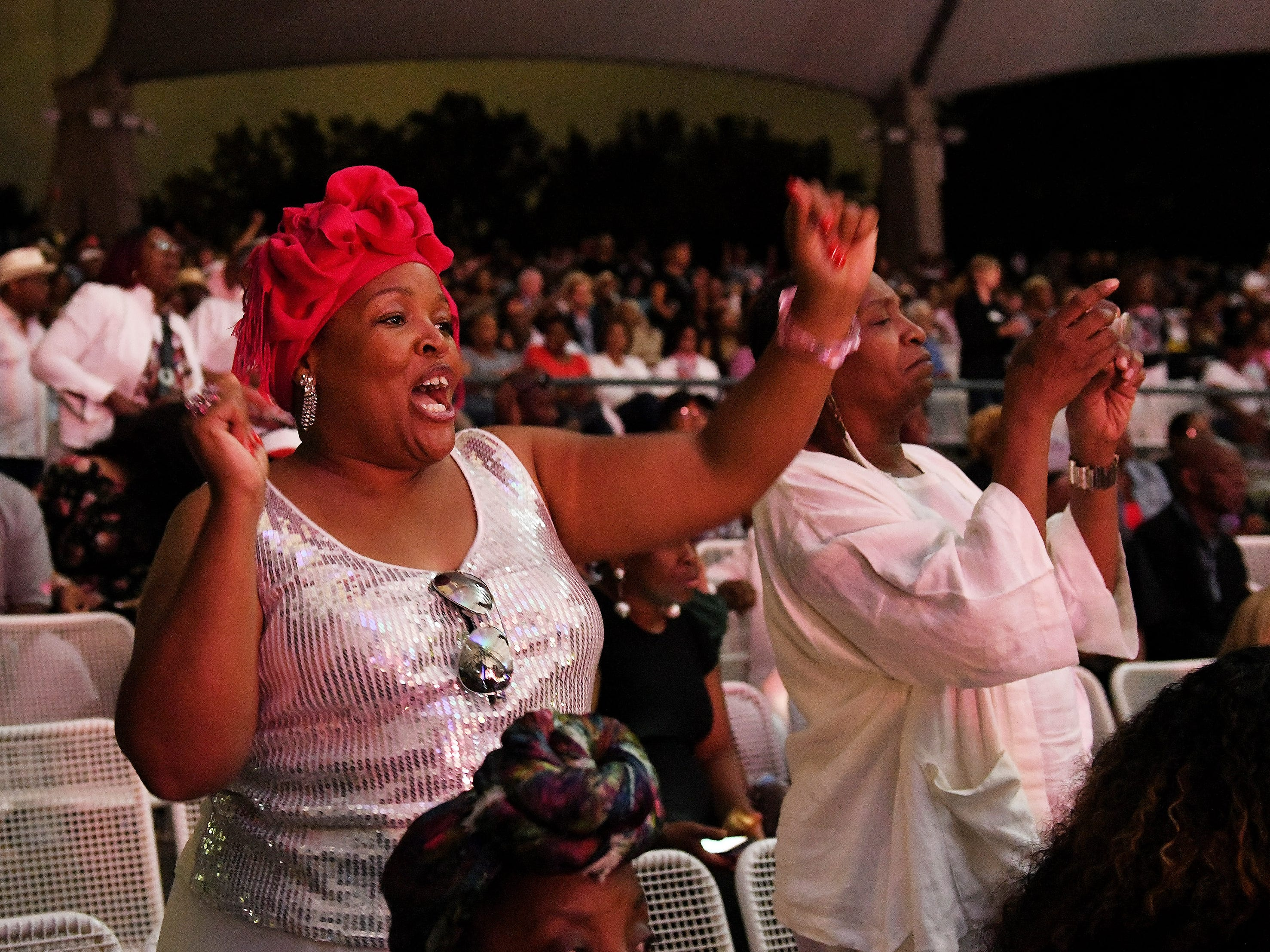 "NeGayle Muhammad of Inkster, left, dances with her godmother, Danni Stillwell of Detroit to ""Jump To It.""  The Aretha Franklin Tribute Concert at Chene Park Ampitheatre in Detroit on Aug. 30, 2018. 