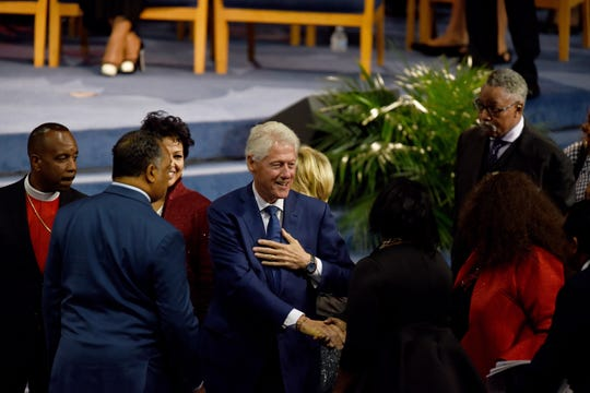 President Bill Clinton is greeted at Aretha Franklin's memorial service at Greater Grace Temple on Friday, August 31, 2018.