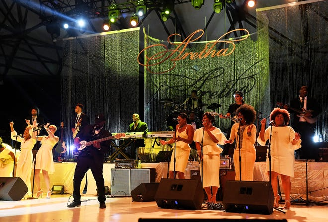 "The band and vocalists perform ""Rock Steady"" with Regina Belle, not pictured.  The Aretha Franklin Tribute Concert at Chene Park Ampitheatre in Detroit on Aug. 30, 2018. 