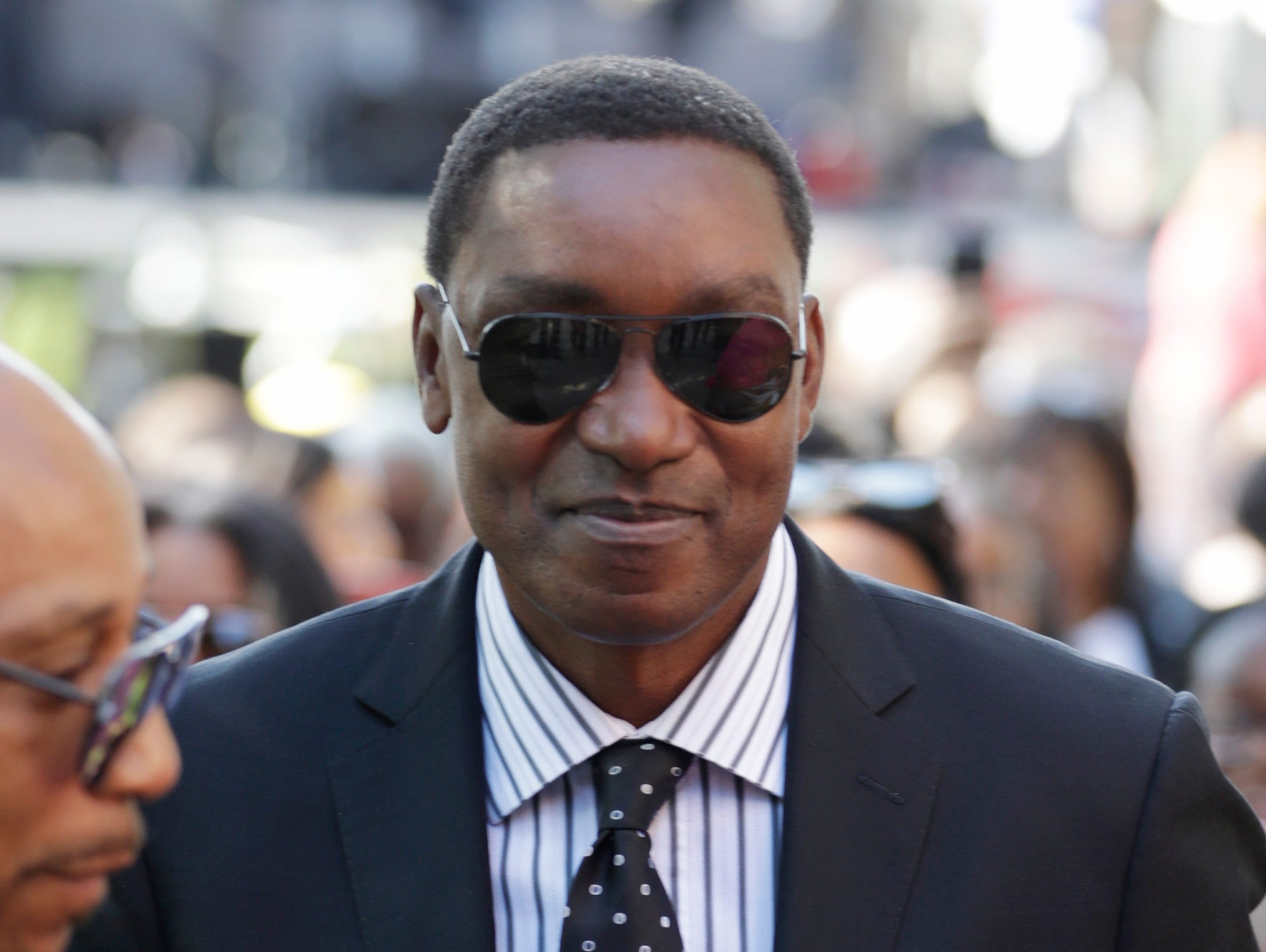 Former basketball player and Detroit Pistons great Isiah Thomas arrives at Greater Grace Temple for Aretha Franklin's funeral.