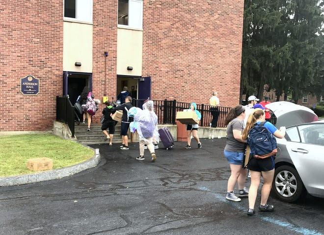 Incoming Elmira College students move into their new living quarters at Anderson Hall on Friday.