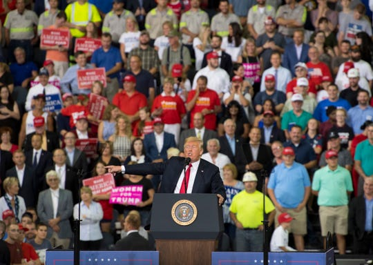 President Donald Trump addresses his supporters at his campaign rally at the Ford Center in Evansville, Ind., Thursday night.