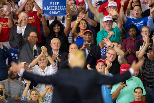 Supporters of President Donald Trump cheer him after his speech at his campaign rally at the Ford Center in Evansville, Ind., Thursday night.
