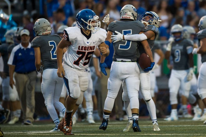 Poudre High School junior linebacker Triston Burkett (5) celebrates with senior defensive back Miguel Arrelano (28) after a big punt return against Legend High School on Thursday, Aug. 30, 2018, at French Field in Fort Collins, Colo.