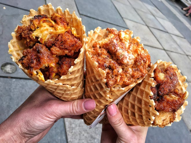 Chick'nCone at The Exchange in downtown Fort Collins rolls its own waffle cones and stuffs it with fried chicken tossed in a variety of sauces.