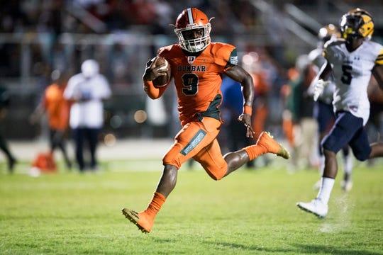 Dunbar High School's Seneca Milledge scores a touchdown against Lehigh on Thursday at Dunbar in Fort Myers. Lehigh beat Dunbar 12-6.