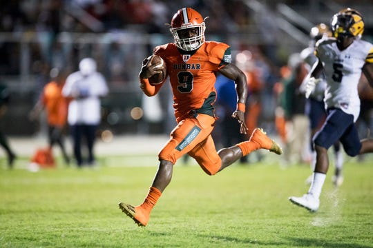 Dunbar High School's Seneca Milledge scores a touchdown against Lehigh on Thursday at Dunbar in Fort Myers. Lehigh beat Dunbar 12-6.