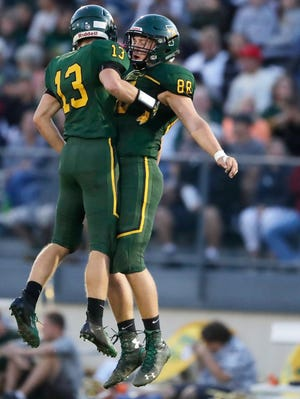 Green Bay Preble's Jagger Vine (13) celebrates after recovering a Green Bay Southwest fumble Thursday in a Fox River Classic Conference game at Preble.