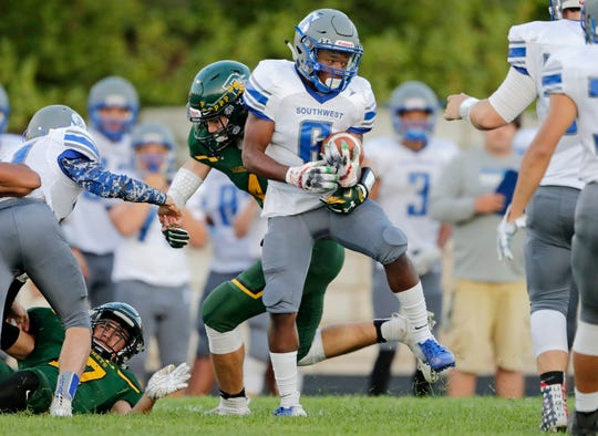 Green Bay Southwest's Josh Yahsha (6) spins away from a tackle against Green Bay Preble in a FRCC football game at Preble high school on Thursday, August 30, 2018 in Green Bay, Wis.
